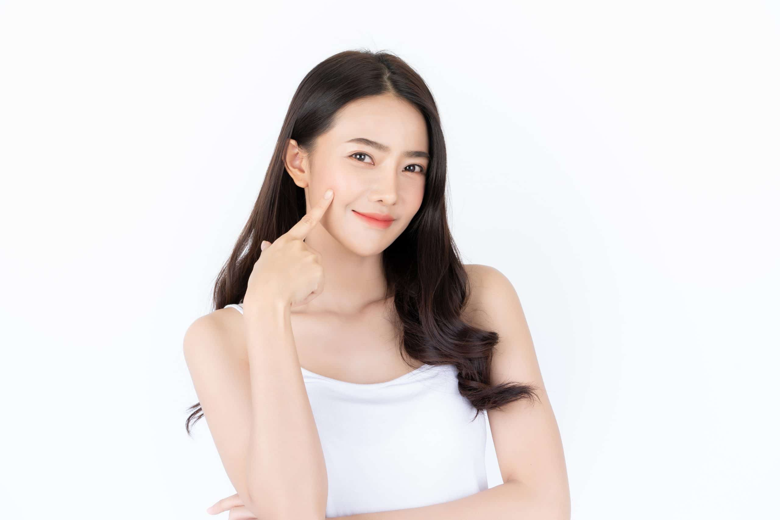 Young,Asian,Woman,Has,Smiling,Face,And,Bright,Skin,Tone.asian